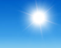 Sun in blue sky Stock Photos