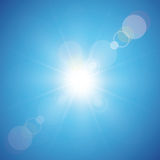 Sun on blue sky background Stock Images