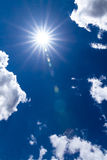 Sun and blue sky. Beautiful airy image of the sun and  some clouds in the dark blue sky Royalty Free Stock Photography