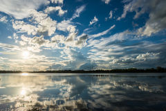 Sun and Blue sky with clouds over the reservoir Stock Photography