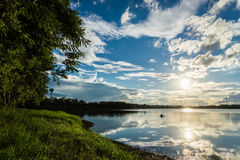 Sun and Blue sky with clouds over the reservoir Royalty Free Stock Images