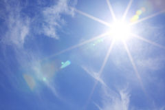 Sun in blue sky Stock Image