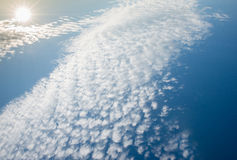 Sun on blue sky with fluffy clouds. Aerial view Royalty Free Stock Photo