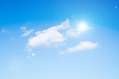 Sun on blue sky with lenses flare Stock Image