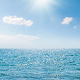 Sun in blue sky over sea Royalty Free Stock Photography