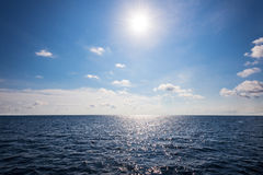 Sun on blue sky and sea in summer Thailand Royalty Free Stock Images