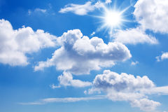 Sun and blue sky. A blue sky with sun, sunbeams and clouds Stock Image
