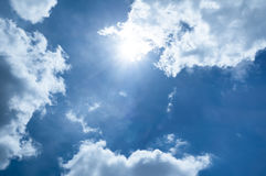 Sun on blue sky with tiny cloud Stock Photos