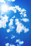 Sun among the blue sky and white clouds Royalty Free Stock Photos