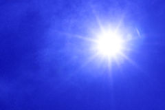 Sun,blue sky. White clouds and sun  in a blue sky. Sky background Stock Photo
