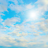 Sun in blue sky and white clouds. Heavenly landscape Stock Images