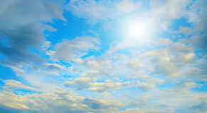 Sun in blue sky and white clouds. Heavenly landscape Stock Photos