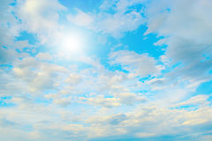 Sun in blue sky and white clouds. Heavenly landscape Royalty Free Stock Images