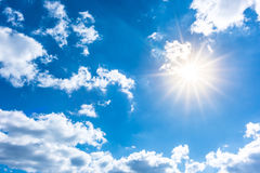 Sun in blue sky Stock Images
