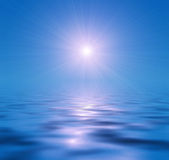 Sun on the blue water Stock Photo