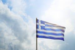 Sun Blue White Greek Flag Summit Acropolis Athens Greece. Cross symbolizes Greek Orthordox Chritiianity, the religion of. Sun Blue White Greek Flag Summit royalty free stock photos