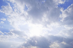 Sun Breaking through Clouds Stock Photo