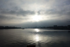 Sun breaking through the clouds. View of the harbor at the hanseatic city of Rostock in Northern Germany Royalty Free Stock Photo