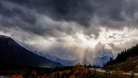 Sun Breaking through Dark Clouds Royalty Free Stock Photo
