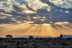 Sun Breaking though the Clouds in Oman stock photography