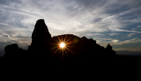 Sun breaking through Turret Arch Royalty Free Stock Image