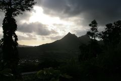 Sun breaks through clouds after an early morning rain in Hawaii royalty free stock photos