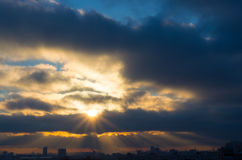 The sun breaks through the heavy winter clouds stock image