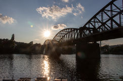 Sun and Bridge Near Sunset Stock Photo