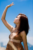 The sun is so bright. Young beautiful alluring girl outdoor trying to block the bright sun light Royalty Free Stock Photography