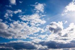 Sun in bright blue sky. Stock Image
