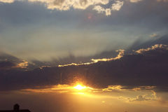 Sun Bubbles. The sun bubbles beneath the evening clouds Stock Photo