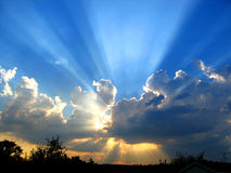 Sun Burst. The sun shining through low cloud royalty free stock photo