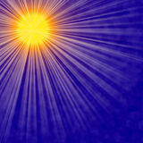 Sun burst Abstract Background. Abstract Sun burst and rays against a dark blue background.  Golden sun and rays against a dark blue bacground with subtle clouds Stock Photography