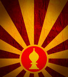 Sun burst background with chess bishop icon. Chess game relative abstract backdrop Royalty Free Stock Photo
