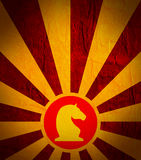 Sun burst background with chess knight icon. Chess game relative abstract backdrop Royalty Free Stock Images