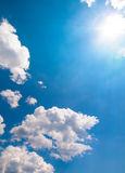 Sun Burst On A Blue Sky And Clouds Stock Photo