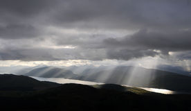 Sun burst through clouds over Loch Linnhe, Glencoe. From Ben Nevis, Scotland Royalty Free Stock Photo