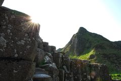 Sun Burst on Hexagonal Stones at Giant`s Causeway royalty free stock images