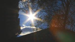 Sun burst in skies Stock Photos