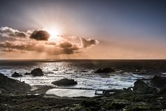 Free Sun Bursting From Behind Clouds, Lands End, San Francisco, California Royalty Free Stock Photography - 135817307