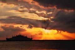 Sun bursts sunset. Sunset sun bursts and silhouette ship Stock Photos
