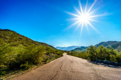 Sun casting its sun rays on the East San Juan Road near the San Juan Trail Head in the mountains of South Mountain Park. In Maricopa County near the city of Royalty Free Stock Images