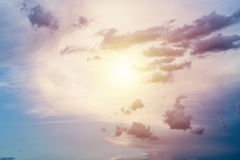 Sun in the center sky. With blue dark clouds background Royalty Free Stock Image