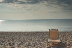 Sun chair on the beach. Sun chair standing alone on a beach Royalty Free Stock Photography
