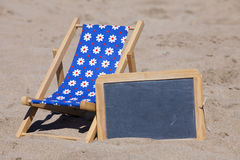 Sun Chair and Slate with Copy Space on the Beach Royalty Free Stock Photos