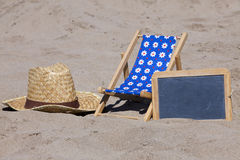 Sun Chair and Slate with Copy Space on the Beach Stock Photo