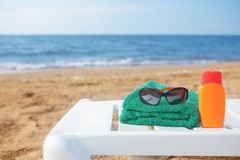 Sun chair, sunblock , sunglasses and towel Stock Photo