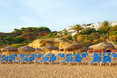 Sun chairs. At the beach Stock Images