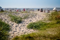 Sun chairs at german north sea beach royalty free stock photography