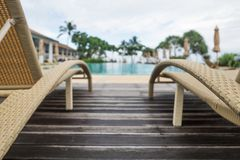 Sun chairs or loungers at the swimming pool. Place for ideal rest stock image